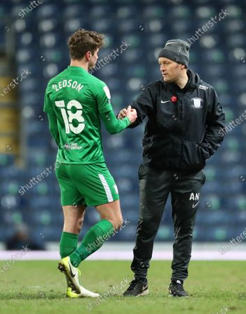 Stock Image of Ryan Ledson of Preston North End shakes hands with Preston North End manager Alex Neill after the final whistle; Ewood Park, Blackburn, Lancashire, England; English Football League Championship Football, Blackburn Rovers versus Preston North End.