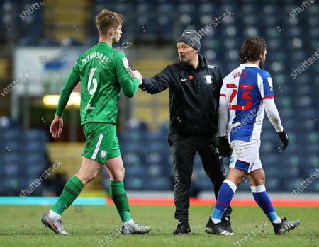 Liam Lindsey of Preston North End shakes hands with Preston North End manager Alex Neill after the final whistle; Ewood Park, Blackburn, Lancashire, England; English Football League Championship Football, Blackburn Rovers versus Preston North End.