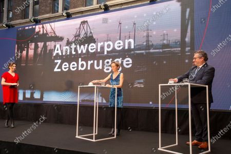 Antwerp harbor alderwoman Annick De Ridder and Brugge mayor Dirk De Fauw pictured during a press conference to announce the merger of the Zeebrugge and Antwerp ports, Friday 12 February 2021 in Antwerp. Negotiations foro the fusion of the two harbours have been going on for several years.