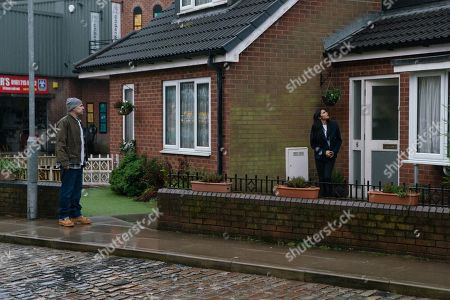 Stock Image of Coronation Street - Ep 10264 Wednesday 3rd March 2021 - 2nd Ep Bolted in the house Yasmeen leans against the sofa gasping for air. Alya Nazir, as played by Sair Khan, and Tim Metcalfe, as played by Joe Duttine, force their way in.