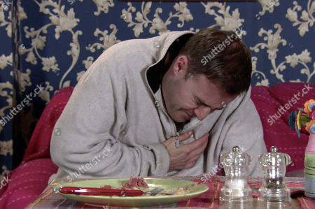 Coronation Street - Ep 10249 Monday 15th February 2021 - 1st Ep As they continue to row over the stolen furniture, Tyrone Dobbs, as played by Alan Halsall, suddenly grips his chest in agony and slumps to the floor. Fiz Stape screams at Evelyn Plummer to call an ambulance.
