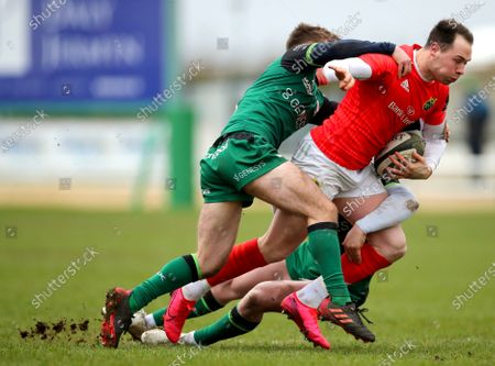 Stock Picture of Connacht Eagles vs Munster A. Connacht's Colm Reilly and Conor Fitzgerald tackle Sean French of Munster