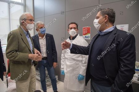 Italian architect Renzo Piano (L) greets Liguria Governor Giovanni Toti (R) after receiving a dose of the Pfizer-BioNTech vaccine against the coronavirus disease (COVID-19) in Genoa, northern Italy, 12 February 2021. Renzo Piano, 83, a world-renowned architect, was the first person to receive the vaccination in Liguria region on the 'Silver Vaccine Day' organized by the ASL3, which opened the vaccination campaign for the over 80s.