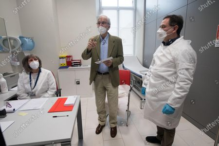 Stock Image of Italian architect Renzo Piano (2-R) after receiving a dose of the Pfizer-BioNTech vaccine against the coronavirus disease (COVID-19) in Genoa, northern Italy, 12 February 2021. Renzo Piano, 83, a world-renowned architect, was the first person to receive the vaccination in Liguria region on the 'Silver Vaccine Day' organized by the ASL3, which opened the vaccination campaign for the over 80s.