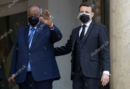 French President Emmanuel Macron (R) greets President of Djibouti Ismail Omar Guelleh (L) as he arrives for a meeting and lunch at the Elysee Palace in Paris, France, 12 February 2021.