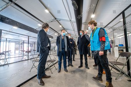 Flemish Minister of Domestic Policy and Living Together Bart Somers, Antwerp Mayor Bart De Wever and Flemish Minister President Jan Jambon pictured during a guided tour of the vaccination facility at the vaccination with the AstraZeneca vaccine of healthcare workers at the vaccination centre in Antwerp, Friday 12 February 2021.
