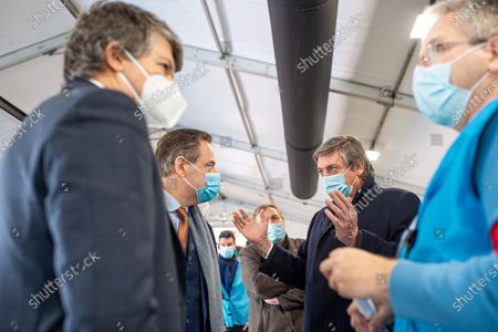 Stock Photo of Flemish Minister of Domestic Policy and Living Together Bart Somers, Antwerp Mayor Bart De Wever and Flemish Minister-President Jan Jambon pictured during a guided tour of the vaccination facility at the vaccination with the AstraZeneca vaccine of healthcare workers at the vaccination centre in Antwerp, Friday 12 February 2021.