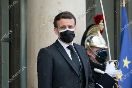 French President Emmanuel Macron welcomes the Djibouti President before their meeting at the Elysee Presidential Palace