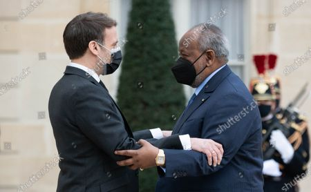Stock Image of French President Emmanuel Macron welcomes Djibouti President Ismail Omar Guelleh before their meeting at the Elysee Presidential Palace