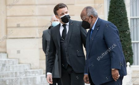 French President Emmanuel Macron welcomes Djibouti President Ismail Omar Guelleh before their meeting at the Elysee Presidential Palace