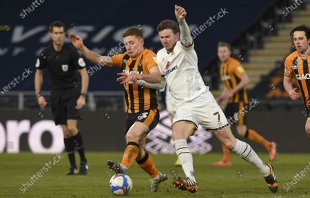 Stock Picture of Greg Docherty of Hull City and Ben Gladwin of Milton Keynes Dons