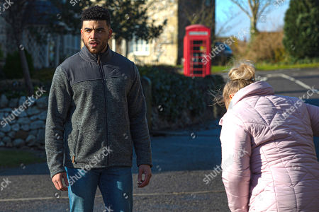 Emmerdale - Ep 8979 Thursday 25th February 2021 - 1st Ep As Cain Dngle drops off the kids belongings, Nate Robinson, as played by Jurell Carter, is clearly pleased to be trusted. Cain's about to head off to meet Moira at the hotel, but when they see Tracy Metcalfe, as played by Amy Walsh, doubled up in pain, they rush to help. Tracy's in denial convinced it's Braxton Hicks but her waters break. Cain goes to get his car leaving Nate and Tracy in a tailspin of panic.