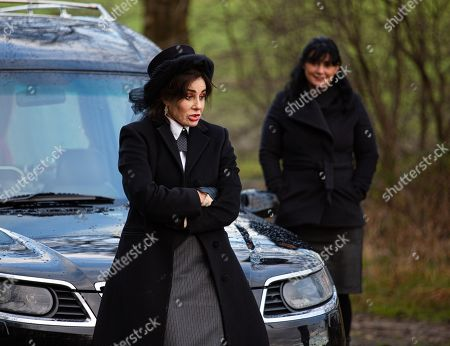 Emmerdale - Ep 8979 Thursday 25th February 2021 - 1st Ep As Moira Dingle, as played by Natalie J Robb, leaves the hotel following Cain's phone call telling her night away is off, she is stunned to bump into Faith Dingle, as played by Sally Dexter, dressed in full mourner's garb. Incredulous, Moira wants answers from edgy Faith, who's clearly desperate to get away.