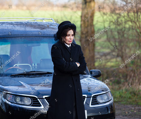 Emmerdale - Ep 8979 Thursday 25th February 2021 - 1st Ep As Moira Dingle leaves the hotel following Cain's phone call telling her night away is off, she is stunned to bump into Faith Dingle, as played by Sally Dexter, dressed in full mourner's garb. Incredulous, Moira wants answers from edgy Faith, who's clearly desperate to get away.