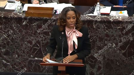 In this image from video, House impeachment manager Del. Stacey Plaskett, D-Virgin Islands, answers a question from Sen. Bob Casey, D-Pa., Sen. Sherrod Brown, D-Ohio, and Sen. Amy Klobuchar, D-Minn., during the second impeachment trial of former President Donald Trump in the Senate at the U.S. Capitol in Washington