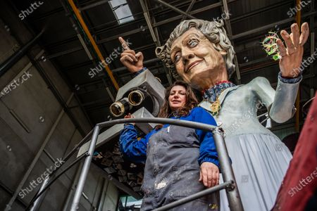 Priscilla Borri shows the float representing Rita Levi Montalcini. The Carnival of Viareggio was born in 1873 and nowadays is the largest Italian folk event. The rules for the prevention of Covid disease this year prevent the traditional parade of floats on Mardi Gras. The Cittadella of Viareggio in the days of the carnival is the nodal center of important events, but this year the sixteen Hangars, where the allegorical floats are built, are full of activity even though the parades have been postponed due to the pandemic of Covid-19.