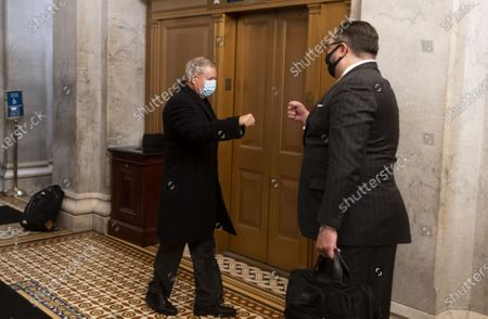 Stock Photo of Sen. Lindsey Graham, R-S.C., (L) gives a fist bump to Jason Miller, Senior Adviser to the Trump 2020 re-election campaign, at the U.S. Capitol before the start of the impeachment trial of former President Donald Trump in Washington, DC,  on Friday, February 12, 2021.   Pool photo By Bill Clark/UPI