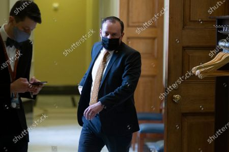 Republican Senator from Utah Mike Lee (R) walks near the Senate chamber during a break in the fourth day of the second impeachment trial of former US President Donald J. Trump in the Senate, at the Capitol in Washington, DC, USA, 12 February 2021. Trump's defense team will present arguments on the fourth day of the Senate impeachment trial of former US President Donald J. Trump, on the charge of incitement of insurrection for his role in 06 January violent attack on the US Capitol.