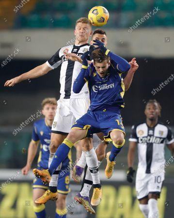 Parma's Andreas Cornelius gets above Verona's Ivan Ilic for a header.