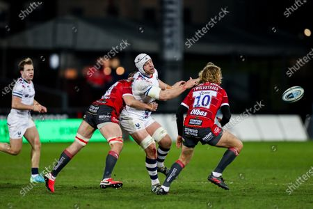 Dave Attwood of Bristol Bears is tackled by Lewis Ludlow and Billy Twelvetrees of Gloucester Rugby