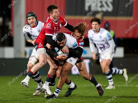 Charles Piutau of Bristol Bears is tackled by Billy Twelvetrees and Henry Trinder of Gloucester Rugby