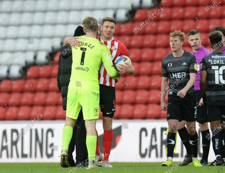 Charlie Wyke of Sunderland who scored four goals celebrates after the full time whistle with Sunderland goalkeeper Lee Burge