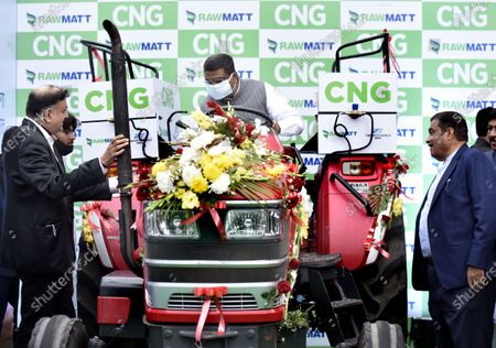 Minister for MSME & Road Transport Nitin Gadkari, Union Ministers Minister for Petroleum & Natural Gas and Steel Dharmendra Pradhan, Launch of India's first CNG tractor and introducing India's first Diesel Tractor Converted to CNG, and media interaction at Motilal Nehru Marg on February 12, 2021 in New Delhi, India. The new tractor introduced today has been converted to CNG from diesel. Union Minister Gadkari is owner of the tractor that was converted to CNG and he was awarded the registration certificate by Dharmendra Pradhan, Minister of Petroleum & Natural Gas and Steel. The government claims that it will help farmers increase their income by lowering operating costs and help in creating job opportunities in rural India.