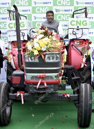 Union Ministers Minister for Petroleum & Natural Gas and Steel Dharmendra Pradhan, site in Tractor during the launch of India's first CNG tractor  at Motilal Nehru Marg on February 12, 2021 in New Delhi, India. The new tractor introduced today has been converted to CNG from diesel. Union Minister Gadkari is owner of the tractor that was converted to CNG and he was awarded the registration certificate by Dharmendra Pradhan, Minister of Petroleum & Natural Gas and Steel. The government claims that it will help farmers increase their income by lowering operating costs and help in creating job opportunities in rural India.