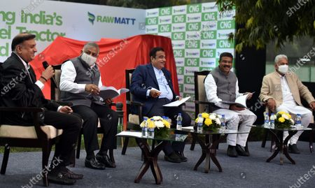 Minister for MSME & Road Transport Nitin Gadkari, Union Ministers Minister for Petroleum & Natural Gas and Steel Dharmendra Pradhan, Union Minister of State for Panchayati Raj, Agriculture and Farmers Welfare Parshottam Rupala and Minister of State for Road Transport and Highways Gen.(Retd) VK Singh address media after launch of India's first CNG tractor  at Motilal Nehru Marg on February 12, 2021 in New Delhi, India. The new tractor introduced today has been converted to CNG from diesel. Union Minister Gadkari is owner of the tractor that was converted to CNG and he was awarded the registration certificate by Dharmendra Pradhan, Minister of Petroleum & Natural Gas and Steel. The government claims that it will help farmers increase their income by lowering operating costs and help in creating job opportunities in rural India.