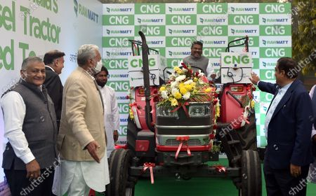 Minister for MSME & Road Transport Nitin Gadkari, Union Ministers Minister for Petroleum & Natural Gas and Steel Dharmendra Pradhan, Union Minister of State for Panchayati Raj, Agriculture and Farmers Welfare Parshottam Rupala and Minister of State for Road Transport and Highways Gen.(Retd) VK Singh during the Launch of India's first CNG tractor  at Motilal Nehru Marg on February 12, 2021 in New Delhi, India. The new tractor introduced today has been converted to CNG from diesel. Union Minister Gadkari is owner of the tractor that was converted to CNG and he was awarded the registration certificate by Dharmendra Pradhan, Minister of Petroleum & Natural Gas and Steel. The government claims that it will help farmers increase their income by lowering operating costs and help in creating job opportunities in rural India.
