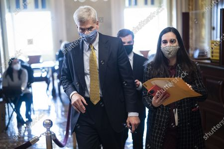 WASHINGTON, DC - FEBRUARY 12: Sen. Bill Cassidy, R-La., walks with staff in the Senate Reception room on the fourth day of the Senate Impeachment trials for former President Donald Trump on Capitol Hill in Washington, DC.