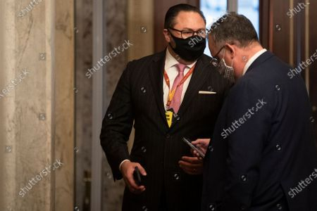 """UNITED STATES - February 12: Jason Miller, Senior Adviser to the Trump 2020 re-election campaign, walks through the first floor of the Senate during the Senate impeachment trial of former President Donald Trump at the U.S. Capitol in Washington. Trump is charged with """"incitement of insurrection"""" after his supporters stormed the Capitol in an attempt to overturn November's election result."""