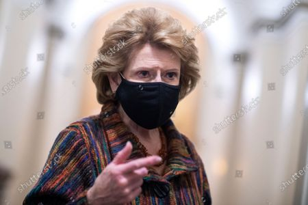 UNITED STATES - FEBRUARY 12: Sen. Debbie Stabenow, D-Mich., talks with reporters in the Capitol during a break in the impeachment trial of former President Donald Trump in Washington, D.C.,. (Photo By Tom Williams/CQ Roll Call/POOL)