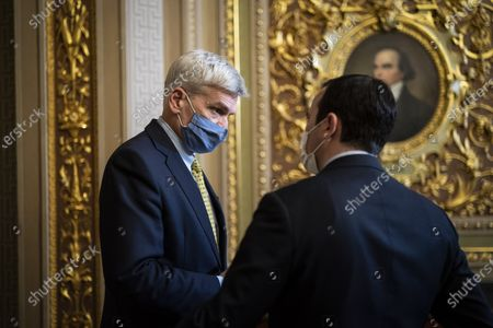 WASHINGTON, DC - FEBRUARY 12: Sen. Bill Cassidy, R-La., talks with staff in the Senate Reception room on the fourth day of the Senate Impeachment trials for former President Donald Trump on Capitol Hill in Washington, DC.