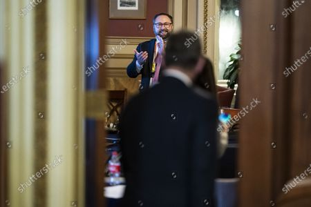 WASHINGTON, DC - FEBRUARY 12: Jason Miller and others clap and cheer as Bruce Castor and Michael van der Veen, lawyers for former President Donald Trump, walk back into their meeting room at the end of the fourth day of the Senate Impeachment trials for former President Donald Trump on Capitol Hill in Washington, DC.