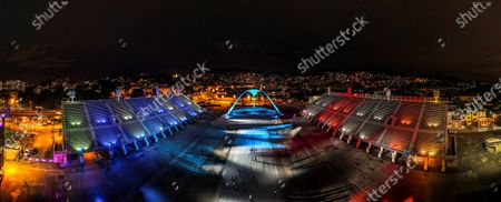 Panoramic photograph taken with a drone that shows the Rio Carnival Sambadrome, empty and illuminated, in Rio de Janeiro, Brazil, 12 February 2021. The Sambadrome, which will remain empty and silent between this Friday and Ash Wednesday due to the cancellation of the most famous Carnival in Brazil due to the covid pandemic, will have special lighting at night in tribute to the victims of the coronavirus. The light show, simulating a carnival parade and highlighting the different colors of the Rio de Janeiro samba schools, was lit this Friday by the mayor of Rio de Janeiro, Eduardo Paes, in a ceremony in which tribute was also paid to the victims of the pandemic.