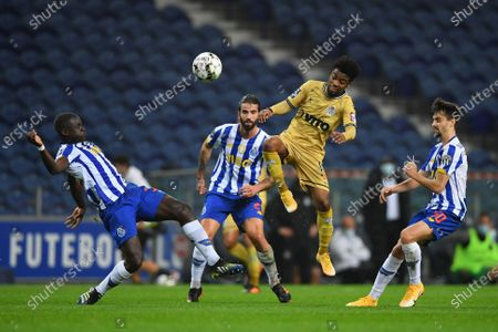 Malang Sarr, Fábio Vieira of FC Porto lose the header to Angel Gomes of Boa Vista; Dragao Stadium, Porto, Portugal; Portuguese Championship Football, FC Porto versus Boa Vista.