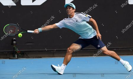 United States' Mackenzie McDonald hits a backhand return to South Africa's Lloyd Harris during their third round match at the Australian Open tennis championship in Melbourne, Australia