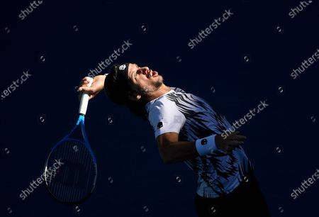 Spain's Feliciano Lopez serves to Russia's Andrey Rublev during their third round match at the Australian Open tennis championship in Melbourne, Australia