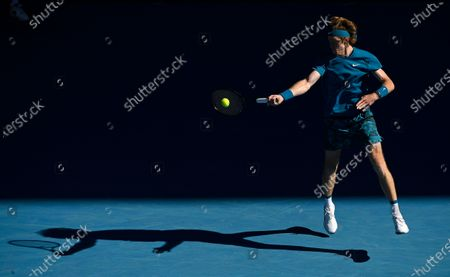 Russia's Andrey Rublev hits a forehand return to Spain's Feliciano Lopez during their third round match at the Australian Open tennis championship in Melbourne, Australia