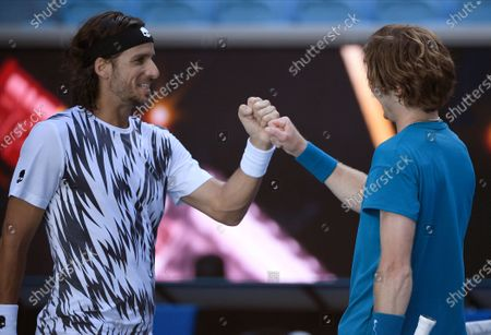 Russia's Andrey Rublev, right, is congratulated by Spain's Feliciano Lopez after winning their third round match at the Australian Open tennis championship in Melbourne, Australia