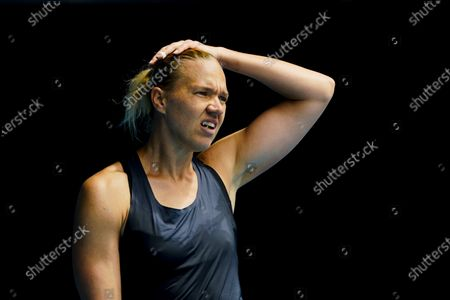 Kaia Kanepi of Estonia reacts while in action against Donna Vekic of Croatia during their third round match at the Australian Open grand slam tennis tournament at Melbourne Park in Melbourne, Australia, 13 February 2021.