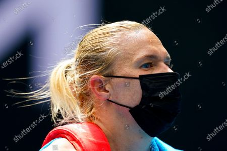 Kaia Kanepi of Estonia walks off the court after loosing her third round women's singles match against Donna Vekic of Croatia at the Australian Open grand slam tennis tournament at Melbourne Park in Melbourne, Australia, 13 February 2021.