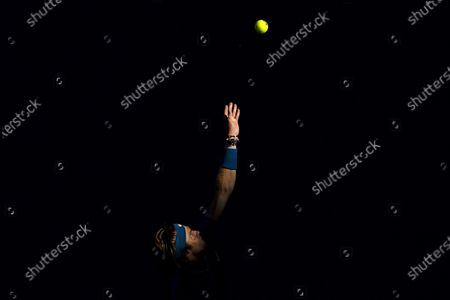 Andrey Rublev of Russia serves during his third Round Men's singles match against Feliciano Lopez of Spain at the Australian Open grand slam tennis tournament at Melbourne Park in Melbourne, Victoria, Australia, 13 February 2021.