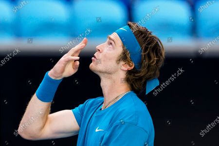 Stock Picture of Andrey Rublev of Russia celebrates after winning his third Round Men's singles match against Feliciano Lopez of Spain at the Australian Open grand slam tennis tournament at Melbourne Park in Melbourne, Australia, 13 February 2021.