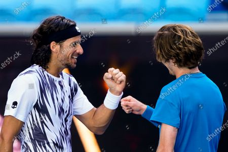 Andrey Rublev of Russia (R) is congratulated by Feliciano Lopez of Spain (L) after winning his third Round Men's singles match at the Australian Open grand slam tennis tournament at Melbourne Park in Melbourne, Australia, 13 February 2021.