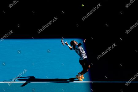 Stock Photo of Feliciano Lopez of Spain serves during his third Round Men's singles match against Andrey Rublev of Russia at the Australian Open grand slam tennis tournament at Melbourne Park in Melbourne, Australia, 13 February 2021.