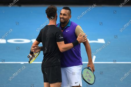 Australia's Nick Kyrgios (R) and Thanasi Kokkinakis celebrate after winning their first Round Men's doubles match against South Africa's Lloyd Harris and Austria's Julian Knowle at the Australian Open grand slam tennis tournament at Melbourne Park in Melbourne, Australia, 13 February 2021.
