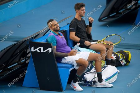 Australia's Nick Kyrgios (L) and Thanasi Kokkinakis on a break during their first Round Men's doubles match against South Africa's Lloyd Harris and Austria's Julian Knowle at the Australian Open grand slam tennis tournament at Melbourne Park in Melbourne, Australia, 13 February 2021.