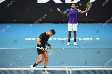Australia's Nick Kyrgios (R) and Thanasi Kokkinakis (L) react during their men's doubles first round match against South Africa's Lloyd Harris and Austria's Julian Knowle at the Australian Open Grand Slam tennis tournament at Melbourne Park in Melbourne, Australia, 13 February 2021.